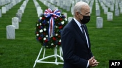 U.S. President Joe Biden looks on after laying a wreath at Arlington National Cemetery in Virginia to honor fallen veterans of the Afghan conflict on April 14. He announced the withdrawal of all U.S. troops from Afghanistan on the same day.