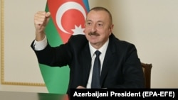 Azerbaijani President Ilham Aliyev gestures as he addresses the nation in Baku on November 9.