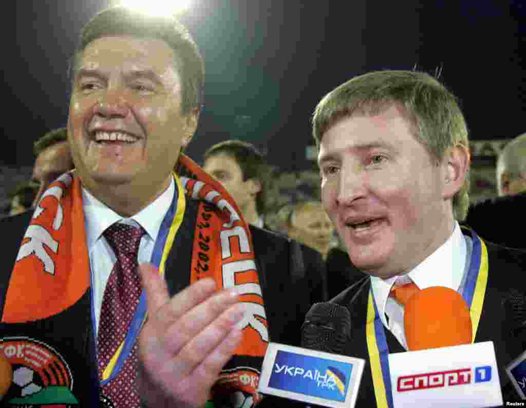 A once-perfect partnership: Akhmetov is considered one of the main beneficiaries of Viktor Yanukovych's political career, trading political support for unfettered access to top government tenders and privatization deals. Here, the two Donetsk natives celebrate a 2006 win by the home side, Akhmetov's Shakhtar Donetsk.