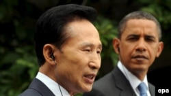 South Korean President Lee Myung-bak (left) speaks at a press conference with U.S. President Barack Obama in Washington.