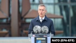 NATO Secretary-General Jens Stoltenberg speaks during a flag-raising ceremony to mark the accession of North Macedonia to NATO at NATO headquarters in Brussels on March 30.