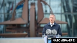NATO Secretary-General Jens Stoltenberg speaks during a flag-raising ceremony to mark the accession of North Macedonia to NATO, at NATO headquarters in Brussels on March 30.