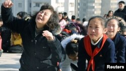 People react as they mourn the death of North Korean leader Kim Jong Il in Pyongyang