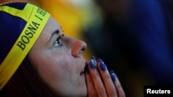 A Bosnian soccer fan reacts after Argentina scores a goal during the 2014 World Cup soccer match.