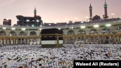 SAUDI ARABIA -- Muslims pray at the Grand Mosque during the annual Hajj pilgrimage in their holy city of Mecca, August 8, 2019