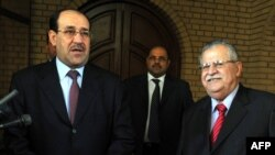 President Jalal Talabani (right) and Prime Minister Nuri al-Maliki in archive photo from Baghdad