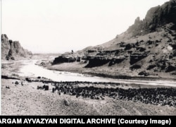 An undated photo showing a section of the cemetery. On the right side of the riverbank is Iran. The Aras River serves as the international border.
