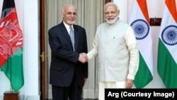 Afghan President Ashraf Ghani and Indian Prime Minister Narendra Modi shake hands on February 9 after signing an agreement to build the Shah Toot on the Kabul River.