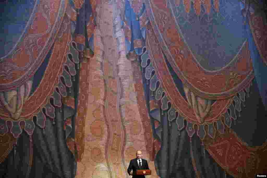 Russian President Vladimir Putin delivers a speech during the grand gala concert that marked the opening of the new Mariinsky Theater in St. Petersburg. (Reuters/Anatoly Maltsev)