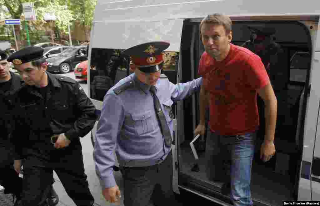 "Navalny is escorted to a court session in Moscow in May 2012. He was detained during an opposition rally a day after the May 7 inauguration of Putin. Navalny was sentenced to another 15 days of jail for ""participating in an illegal public event."""