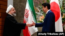 Iranian President Hassan Rohani meets with Japanese Prime Minister Shinzo Abe in Tokyo, December 20, 2019