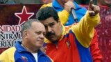 Venezuela -- Venezuelan President Nicolas Maduro (R) speaks with the president of the National Assembly, Diosdado Cabello after receiving the decree powers law, in Caracas, March 15, 2015