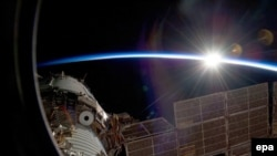 The sun over the International Space Station from the Russian section of the orbital outpost, photographed by one of the STS-129 crewmembers in November 2009.