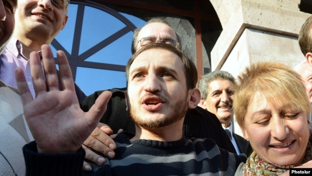 Armenia - Opposition activist Tigran Arakelian is greeted by supporters after being released from prison, Yerevan, 14Oct2013.