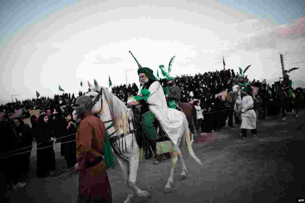 A performer, Ali Aghazedeh, takes the role of the Prophet Muhammad's grandson, Imam Hussein, as he enters the battle field.