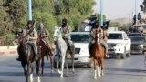 مقاتلون من داعش في شمال الرقة (من الارشيف)
