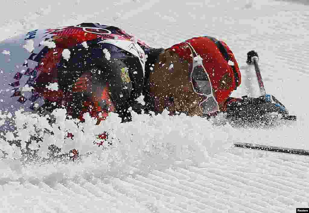 Russia's Alexander Legkov falls on the ground after winning gold in the men's cross-country 50-kilometer marathon. Russia took all three medals in this race. (Reuters/Stefan Wermuth)