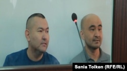 Kazakh activists Talghat Ayan (left) and Maks Boqaev in an Atyrau courtroom on October 12.