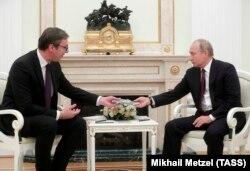 Russian President Vladimir Putin (right) meets with Serbian President Aleksandar Vucic at the Kremlin in Moscow on October 2.