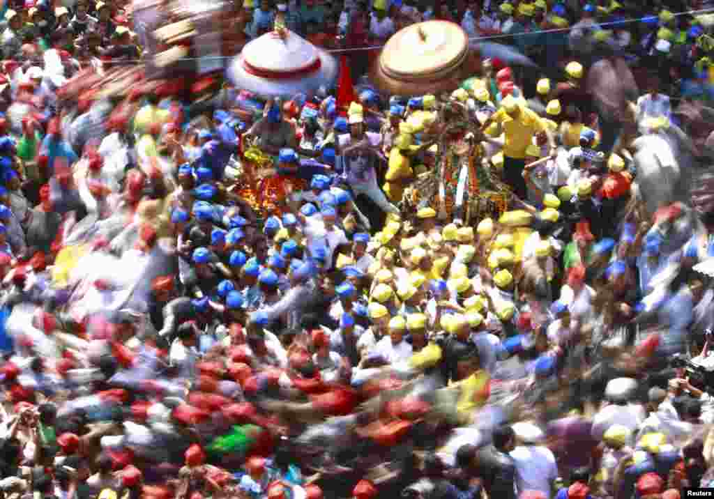 Devotees gather around chariots during the Chariot Festival at Ashon in Kathmandu, Nepal. (Reuters/Navesh Chitrakar)
