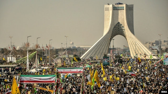 Iranians attend a rally in Tehran to mark the 34th anniversary of the Islamic revolution on February 10.