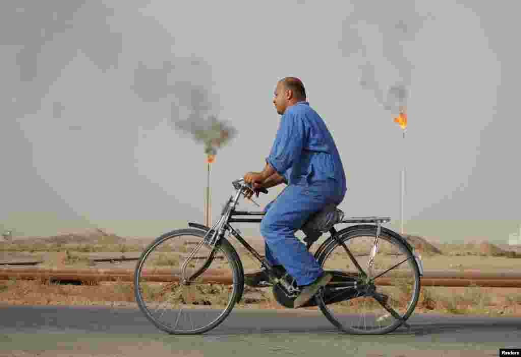 A worker rides a bicycle at a Najaf oil refinery in Iraq. (Reuters/Ahmad Mousa)