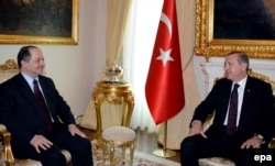 Iraqi Kurdish leader Masud Barzani (left) meets with Turkish Prime Minister Recep Tayyip Erdogan in Ankara on July 14.