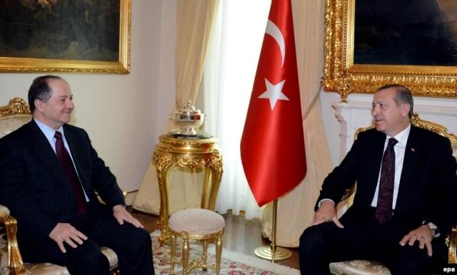 Iraqi Kurdish leader Masud Barzani (left) meets with Turkish Prime Minister Recep Tayyip Erdogan in Ankara on July 14.