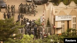 Mali -- Soldiers and security forces gather at the offices of the state radio and television broadcaster after announcing a coup d'etat, in the capital Bamako, 22Mar2012