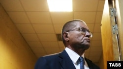 Aleksei Ulyukayev attends a hearing on bribery charges at a Moscow court on November 15.