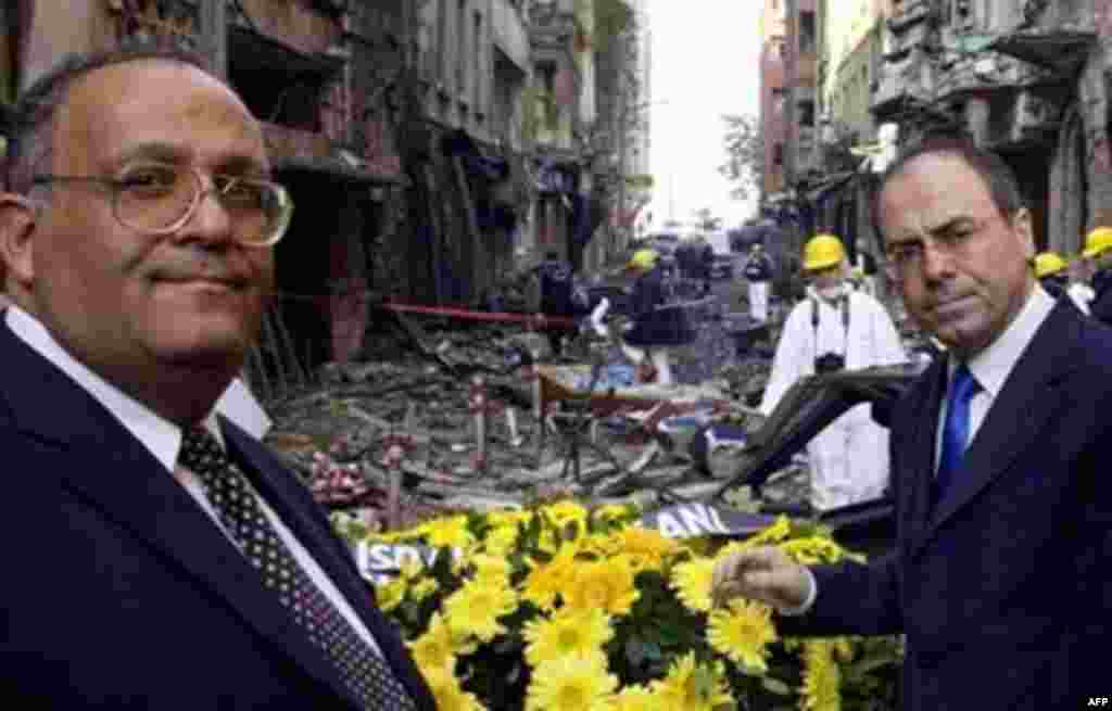 Israeli Foreign Minister Silvan Shalom (right) lays a wreath outside an Istanbul synagogue on November 16, 2003 (AFP) - Terrorists killed 23 people in two, near-simultaneous car-bomb attacks on synagogues in Istanbul on November 7, 2003. Six weeks later, on December 20, 2003, two bombings against British targets in Istanbul leave 27 dead and some 450 injured.