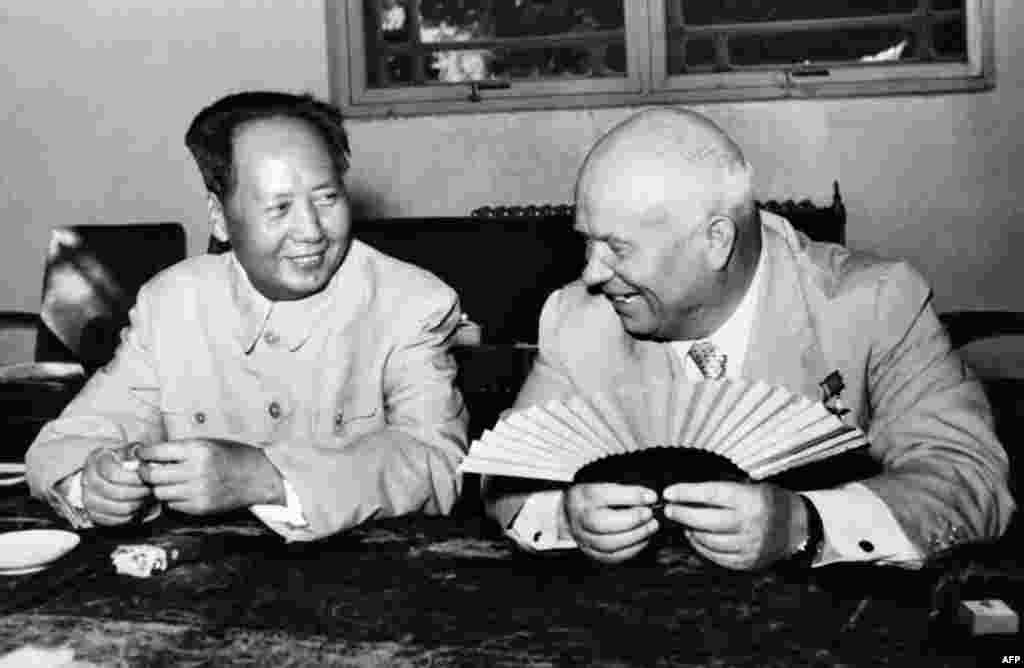 Khrushchev's moderate policies toward the West and his rejection of Stalinism led to a split with Communist China. In this picture, the visiting Soviet leader speaks with Mao Zedong in 1958.
