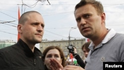 Sergei Udaltsov (left) and Aleksei Navalny speak at the May 6 opposition rally.