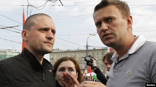 Opposition leaders Sergei Udaltsov (left) and Aleksei Navalny speak together during an opposition protest in central Moscow earlier this month.