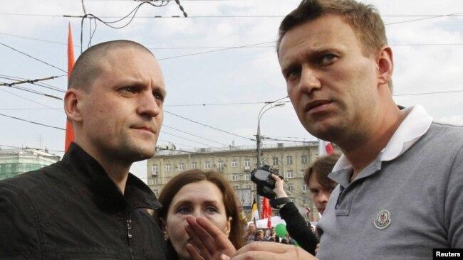 Udaltsov (left) and anticorruption activist Aleksei Navalny speak during the Bolotnaya protest in Moscow on May 6, 2012.