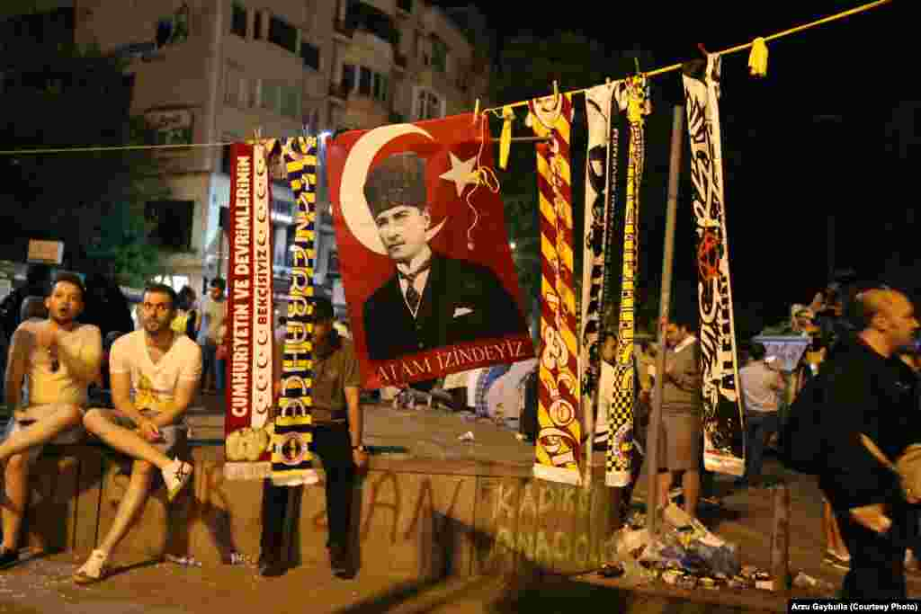 Scarves of Turkey's football teams surround a flag with the image of Mustafa Kemal Ataturk, the founder of modern Turkey.