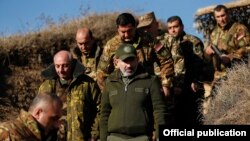Armenian Prime Minister Nikol Pashinian (in cap) visits a section of the Line of Contact in November 2019.