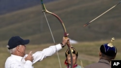 U.S. Vice President Joe Biden tries his hand at archery during a visit to the Mongolian capital, Ulan Bator.