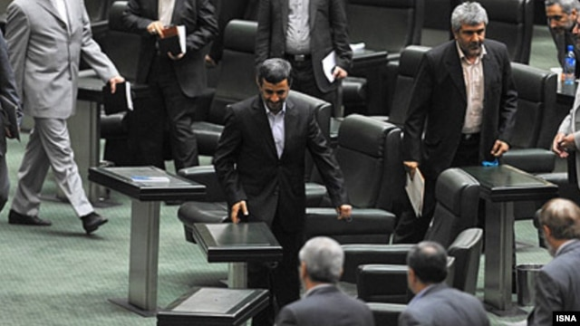 "Iranian President Mahmud Ahmadinejad was summoned to explain his government's ""procrastination in managing"" the economy."