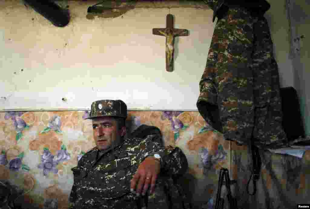 An ethnic Armenian soldier takes a rest at an artillery position near the town of Martuni in Azerbaijan's breakaway region of Nagorno-Karabakh. Dozens of people were killed in Nagorno-Karabakh in fighting that erupted on April 2 between Azerbaijan's military and Armenia-backed separatists. (Reuters)