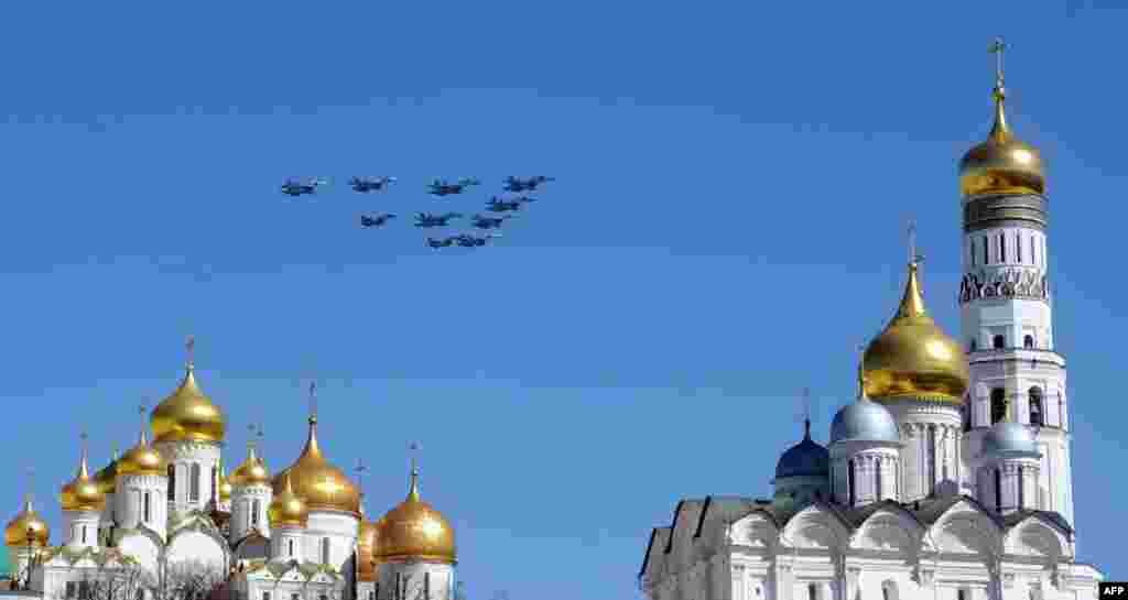 Russian fighter jets fly over the Kremlin cathedrals during a rehearsal of the Victory Day parade in Moscow. (AFP/Viktor Drachev)