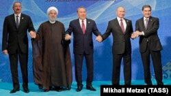 (Left to right:) Azerbaijani President Ilham Aliyev, Iranian President Hassan Rohani, Kazakh President Nursultan Nazarbaev, Russian President Vladimir Putin, and Turkmen President Gurbanguly Berdymukhammedov pose after the signing ceremony for a new convention on the status of the Caspian Sea on August 12.