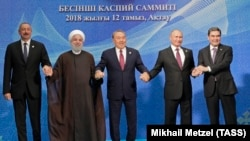 Left to right: Azerbaijani President Ilham Aliyev, Iranian President Hassan Rohani, Kazakh President Nursultan Nazarbaev, Russian President Vladimir Putin, and Turkmen President Gurbanguly Berdymukhammedov pose after the signing ceremony for a new convention on the status of the Caspian Sea on August 12.
