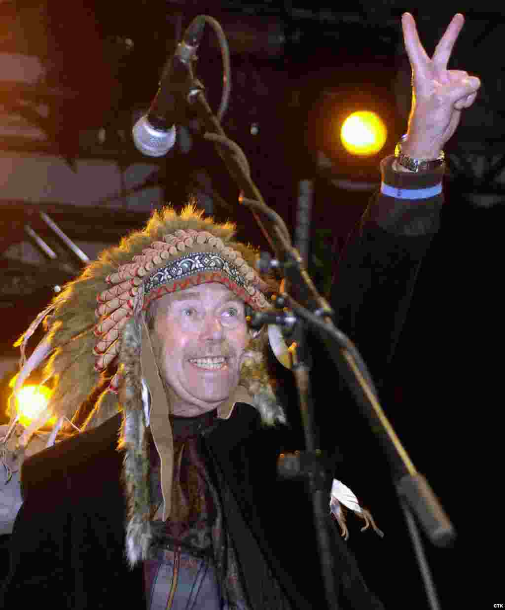 "Havel, who was an ardent fan of rock music, greets the crowd at an open-air festival in the Bohemian town of Trutnov in 2007. The festival was dedicated to ""Chief Havel,"" hence the headdress. (Alexandra Mlejnkova)"