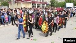 Похороны Андрея Максименко, убитого продавца магазина «Паллада». Актобе, 8 июня 2016 года.