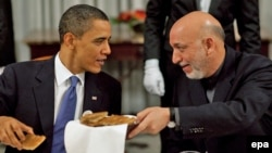 U.S. President Barack Obama (left) invited his Afghan counterpart, Hamid Karzai, to a Chicago NATO summit in May where the alliance is to define the next transition phase.