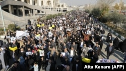 Pro-government demonstrators march in support of the regime after the weekly Friday Prayers in Tehran on January 5.