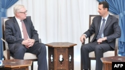 Russian Deputy Foreign Minister Sergei Ryabkov (left) meets with Syrian President Bashar al-Assad in Damascus in mid-September.