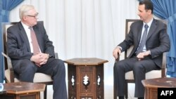 Syrian President Bashar Assad meets with Russian Deputy Foreign Minister Sergei Ryabkov in Damascus on September 17.