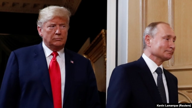 Photo Gallery: Перші фото зустрічі Трампа і Путіна